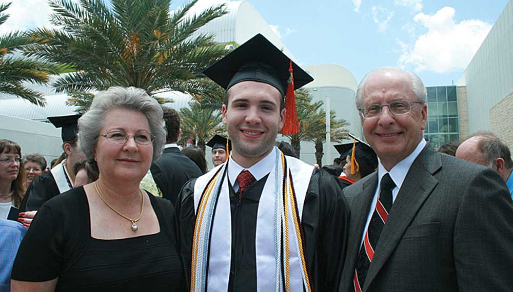 a student and his family at graduation
