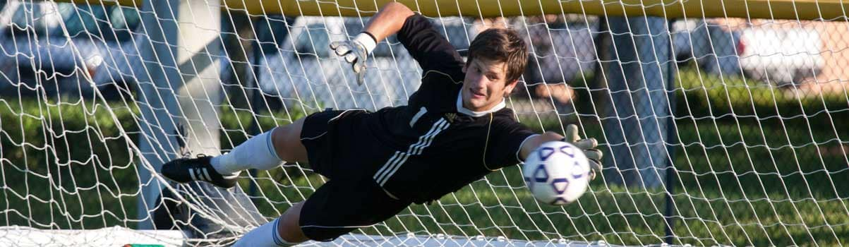 ERAU soccer goalie makes a save.