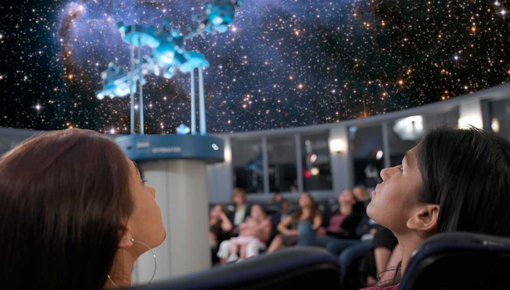 students in the planetarium