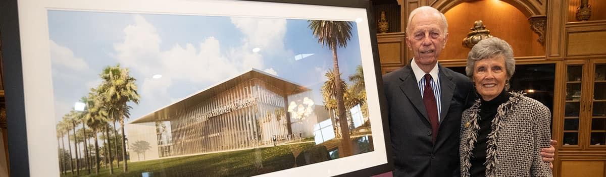 Four people holding oversize check from Spirit Airlines