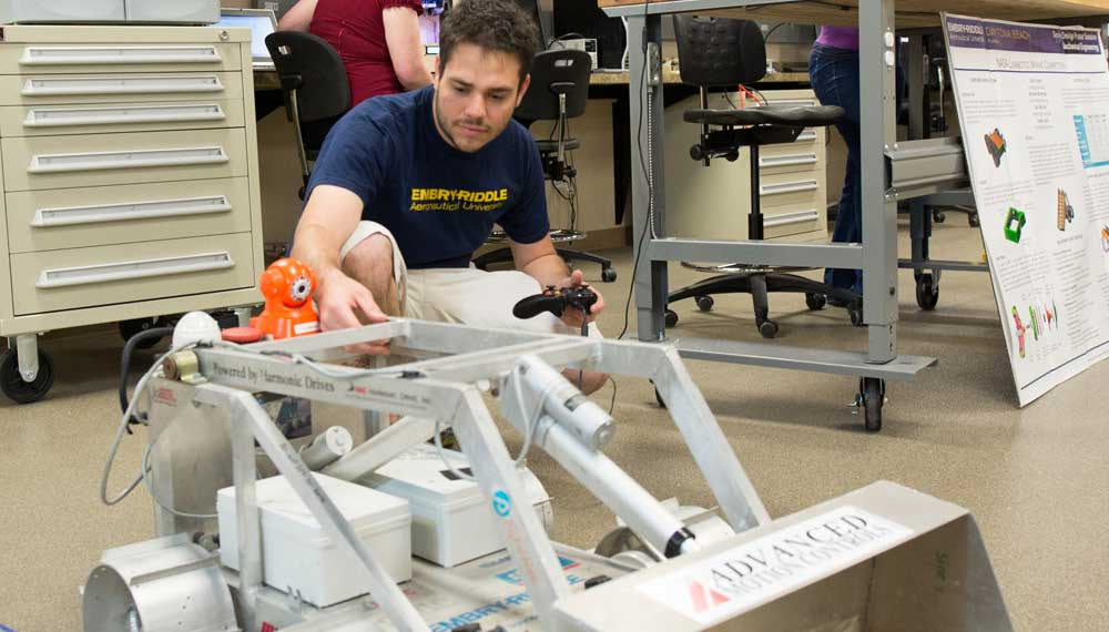 Student works on an autonomous vehicle.