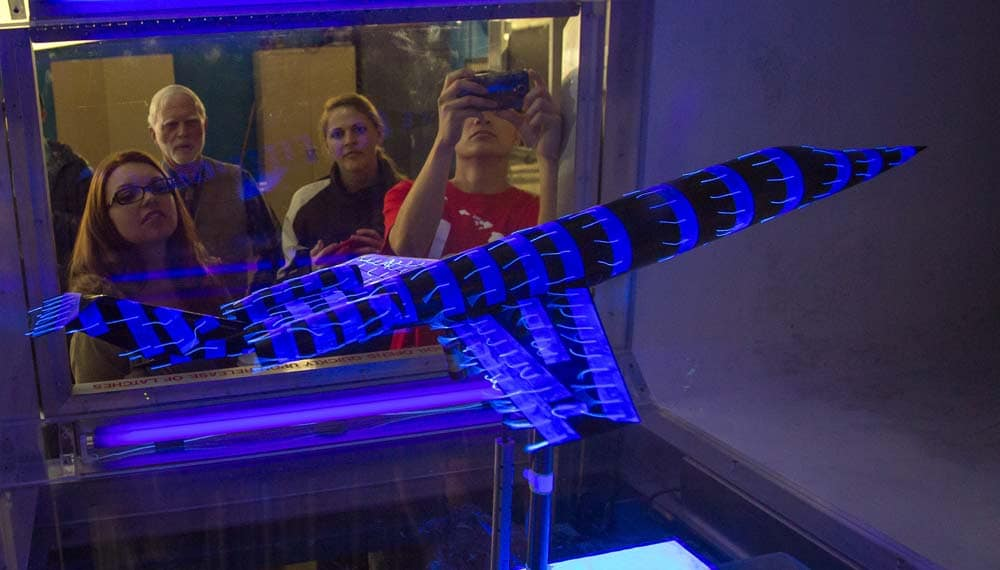 Prescott students and faculty work on a wind tunnel project.