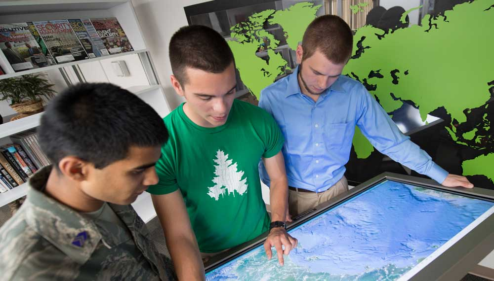 Students look at a map.